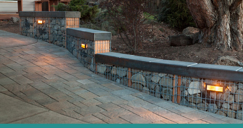 Rock cage retaining wall - Good Life Landscaping